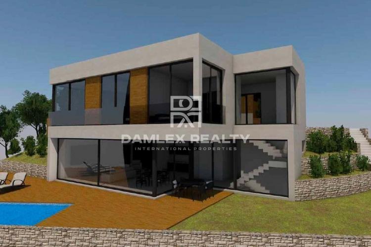 Nueva villa con vistas al mar en una urbanizacióncon con seguridad.